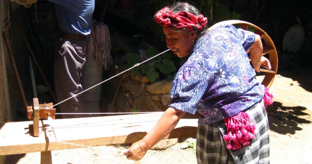 Weaver Paulina Chávez Gutiérrez spinning wool in Teotitlan, Oaxaca, Mexico