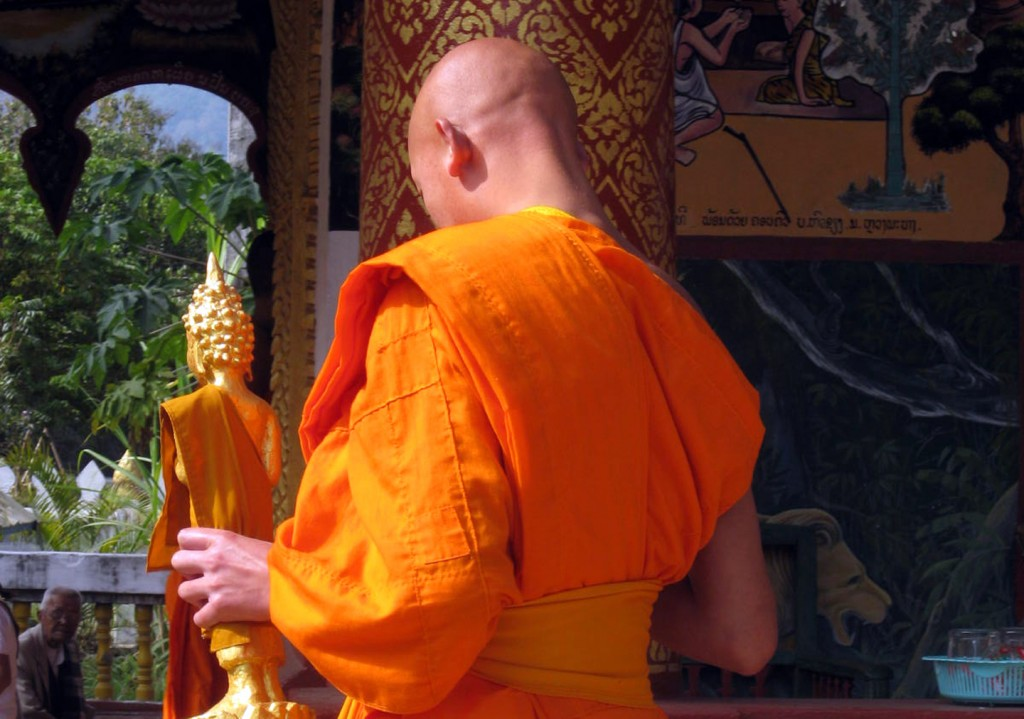 Buddhist monks are everywhere in Luang Prabang