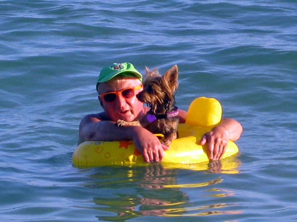Man and dog afloat in Key West, Florida, USA