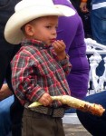 Boy eating corn, Expo Membrillo 2010, in Atotonilquillo, Jalisco, Mexico