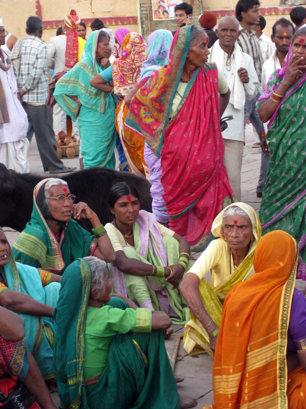 Women in colorful saris on the ghats of Varanasi, India