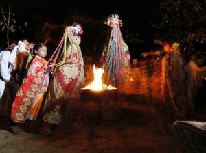 Nighttime cultural dance at Banjaar Tola Tented Camp in Kanha National Park, India