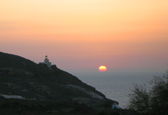 Sunset over Akritiri Lighthouse - Santorini, Greece