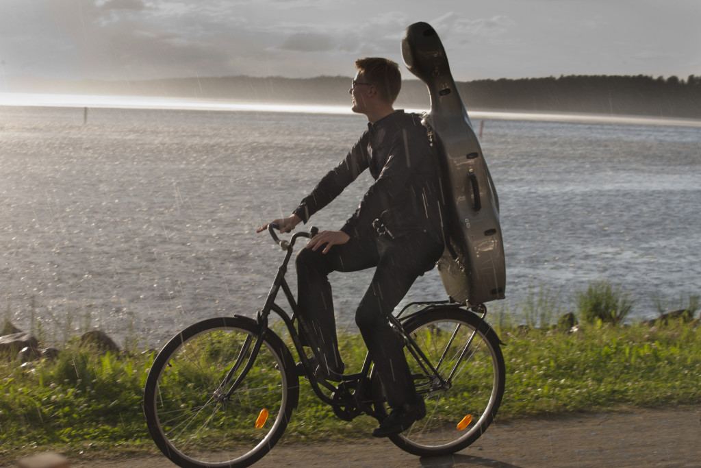 A musician pedaling to a concert at the Kuhmo Chamber Music Festival