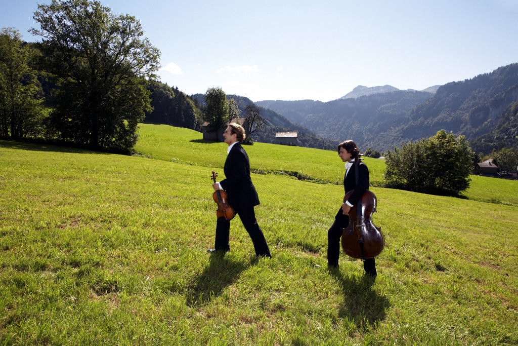 Musicians making their way to the mountain lodge for a concert at Schubertiade.